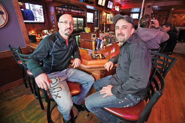 Chaz Hastings, left, seen here at Bottoms Up tavern, has reopened Von Rothenburg Bier Stube in Germantown.