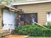 Contractors perform repair and restoration work at Lake Lawn.