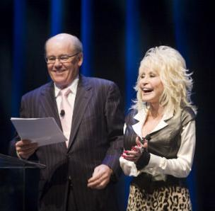 Gaylord Entertainment CEO Colin Reed and Dolly Parton at the project's announcement earlier this year.