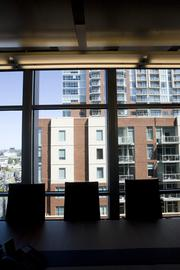 The offices of DVL in Terrazzo. The Icon condominium is visible outside the window.