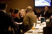 Kara Smith, center, laughs with coworkers at Dave and Buster's. The group works with Republic Services out of Huntsville, Alabama and is in town for a business meeeting.