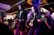 Chris Hawkins and Danielle Napeir play Guitar Hero at Dave and Buster's. The couple is visiting Nashville from Baton Rouge, Louisiana.