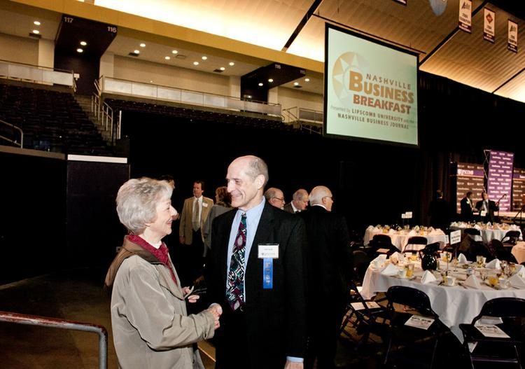 Tom Seals greets Marie Byers during the Nashville Business Breakfast at Lipscomb University.