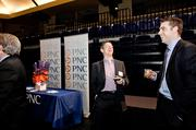 Paul Stanley, left, laughs with Scott Van Dusen during the Nashville Business Breakfast at Lipscomb University.