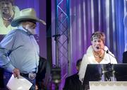 Charlie Daniels and liver transplant recipient Julie Damon present the Lifetime Medical Achievement Award to Dr. C. Wright Pinson.