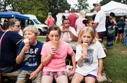Josh Lieberg, left to right, with his  sisters Lauren Frahm and Julie Lieberg, eat ice cream from Hit & Miss  Ice Cream. It was the siblings' first visit to a food truck.