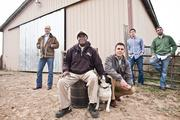 Landowner and grass fed-beef farmer Jesse Dotson, center left, sits with Josh Kaywood, from left, Migeul Sanchez, Brent McMahan and Michael Chapman, all of Wild and Local Foods, a Nashville purveyor connecting consumers with local food.