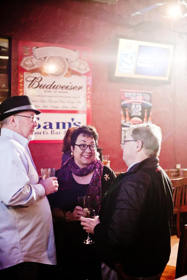 """John Taylor, left and his wife Christine, both of JTMarCom, talk with Roland Yarbrough, of FedEx, during the monthly Nashcocktail at Sam's Sports Bar on Nov. 27. """"It's a great way to meet really talented programmers,"""" said Christine. The event was started by local entrepreneur and technology leader Dave Delany to bring Nashville's social media enthusiasts, digital marketers, bloggers, podcasters, designers, developers and content creators together to enjoy a drink, network and collaborate."""