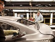 Nima Farzaneh, left, and Shane Hoffman work on the production line at