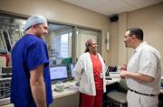 Dr. Greg Bashian jokes with Carol Thompson, middle, and Aaron Elmore before the operation.