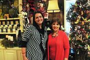 Rebel Hill Florist recently held its annual Holiday Open House. The two-day event benefited Nashville CARES and Ronald McDonald House.  Pictured are Kendra Cotton, left, of Nashville Cares and Anna Page of Rebel Hill Florist.