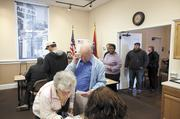 Richard Harper and his wife, Opanl, waited in turn to vote Tuesday during the presidential elections at the Amqui Station & Visitors Center polling station in Madison.