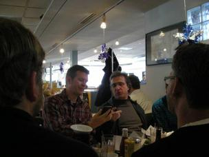 Geek Breakfast founder Dave Delaney talks tech with software developer Sam Walton at the monthly breakfast at Noshville.