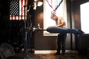 An employee works on a pair of Imogene + Willie jeans.