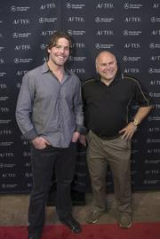 """Mike Fisher, left, and Barry Trotz, of the Nashville Predators, attend the """"After"""" film premiere."""