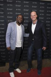 """Jordan Babineaux, left, and Matt Hasselbeck, of the Tennessee Titans, attend the """"After"""" film premiere in Franklin."""