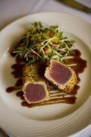 Wasabi and panko crusted ahi tuna steak with sesame cucumber salad. $21.90.