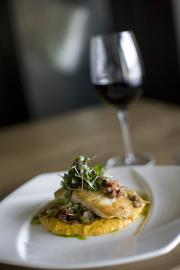 Fish N' Grits: Sea-to-fork catch with Falls Mills sweet potato grits, Southern greens and vinaigrette. $28.00.