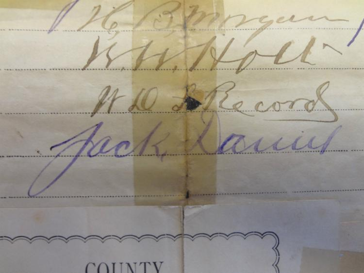Jack Daniel's signature is visible in blue, at the bottom of a list of area businessmen.