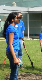 HCA employee Amrit Dhillon after working on Progress' garden.