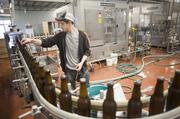 Chase Wilkerson works in the bottling operations at Blackstone Brewing Company's new facility.