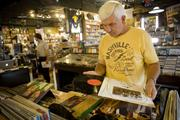 Records from United Record wind up in record shops like Grimey's in Nashville, where James Leach, of Jellico, Tenn., shops for records.