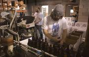 Chris Davis, right, and Colin Foy work to package at Yazoo Brewery.