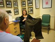 Jennifer Baker shows Dr. Charles Morton, the medical director and surgeon at the Baptist Hospital Metabolic Surgery Center, the pants she wore before her Lap-Band surgery. Baker underwent the procedure on July 3, 2007, and has lost 180 pounds. The center performs at least 125 procedures a year.