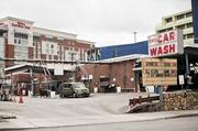 A car wash across the street from the new site is the type of property expected to be a redevelopment target.