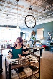 A customer shops at Hester & Cook, a pop-up shop in Hillsboro Village.