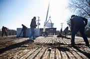 Crew members of Middle Tennessee Roofing Co. install a roof atop of 21st Century Christian, a business along the 12th Avenue South business district.