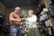Susan Cavender talks with customer Jeff Tanner.