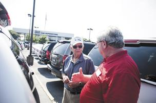 Jack Douglas of Murfreesboro talks with salesman Lloyd Harris at the Freeland Chevrolet Superstore in Antioch. Douglas said he is considering a variety of options in purchasing a Suburban or similar sport-utility vehicle.