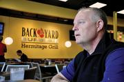 Back Yard Burgers CEO Bob Page plans to grow the chain at a slower pace, after cutting back locations in recent years.