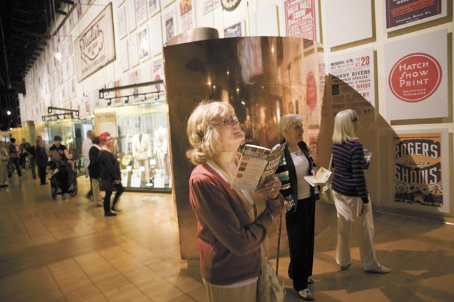 From left, Vivienne McHugh and Anne Oastler, both of Preston, England, and Marilyn Jones, of Cardiff, South Wales, visit the Country Music Hall of Fame. The women are visiting Nashville with a tour group from the United Kingdom.