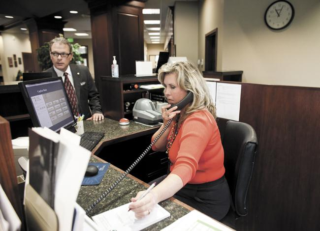 Jason Kotler, assistant vice president, left, and financial services representative Tammy McClung work in the Hendersonville office of CapStar Bank, a Nashville-based lender that started in 2008 and has five branches in the region. The bank recently acquired American Security Bank & Trust.
