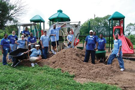 A group of Deloitte employees perform volunteer work at Smithson Academy as part of the firm's Impact Day. A recent survey found that 72 percent of workers would choose to work for a business that supports charitable causes.