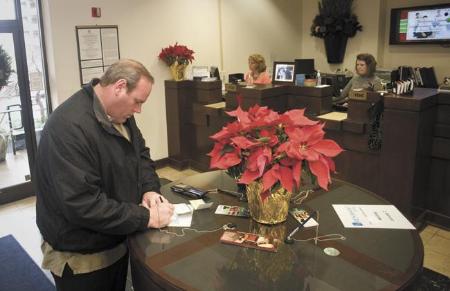 Nashville resident Joe Jackson stops by a Renasant Bank branch. Officials at Renasant and other banks are looking at ways to encourage more customers to use direct deposit for their accounts.