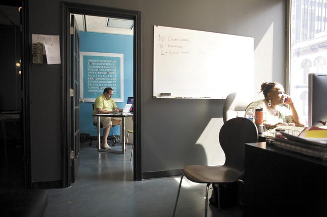 Thomas Scott, left, and Karynn Hough are with Brand Journalists, a resident company in CoLab downtown. The facility offers co-working desks as well as short-term office suites. Costs for a desk can range from $10 a day to $125 for a full month.