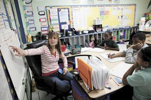 Kelli Kleeman teaches math to fourth-grade students Robert Robinson, from left, Tristan Brown and Jayla Hughes at Kirkpatrick Elementary Enhanced Option School. Several public schools have started providing tutoring instead of using private companies. Kirkpatrick offers four free tutoring opportunities for students.