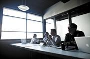 Michael Burcham, from left, Eric O'Reilly, David Abbott and Scott Rouse listen to startups pitch at the Entrepreneur Center.