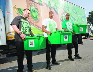 Clinton Gray, from left, Derrick Moore and Emanuel Reed founded The Green Truck Moving Co. about two years ago.