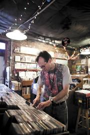 Bill Fondren searches for music Tuesday at Grimey's New & Preloved Music store.