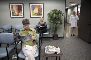 Employees wait at the Health To You clinic on the corporate campus of HCA in Nashville. The health care giant operates 18 similar clinics across the country, touting returns of $2 in savings for every $1 invested.
