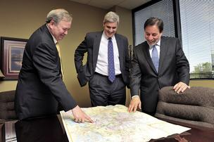 John Snyder, Jon Albright and Anthony Lopes check out a map of the Nashville area, where their firm is opening an office.