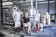 Steve Wright, left to right, Robyn Virball and Bailey Spaulding co-own Jackalope Brewing Co. The microbrewery and taproom opened in 2011 on Eighth Avenue and serves 13 brews throughout the year.