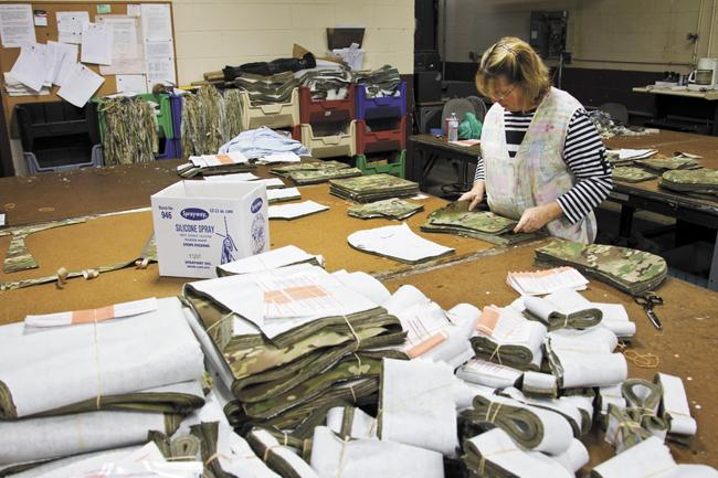 Tullahoma Industries, which makes military uniforms, is preparing to launch a new line of jeans at its factory. It has spent more than $1 million to ramp up production.