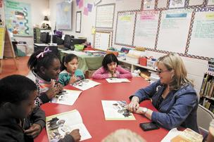 Kim helps her students Mikhail Cook, from left, Zykerria Adams, Joanna Perales and Karla Rueda at Howard Elementary School. Howard and other Sumner County schools had a delayed start this year due to budget disagreements.
