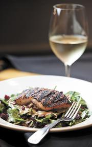 Salad with blackened salmon at Midtown Cafe. This summer was the largest spike in transactions since 2007, said owner Randy Rayburn.