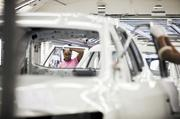 An employee works on the primer painting line at the Nissan North America plant in Smyrna.